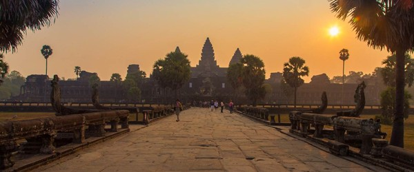 Scenic view of Angkor Wat from the entrance gate at dawn