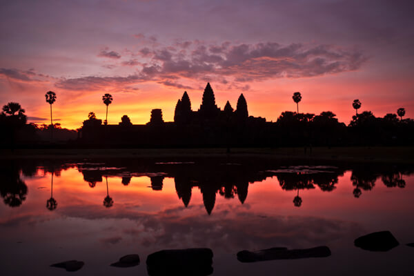 sunset over angkor temple