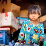A little girl in a small vendor in Siem Reap