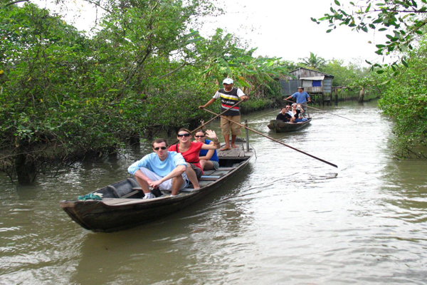 Boat trip through the canals of Mekong Delta in Ben Tre