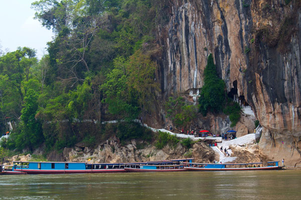 Boat trip to visit Pak Ou Caves - Indochina 21 Day Tour
