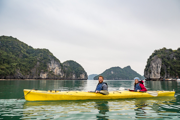 Kayaking between the majestic Halong Bay