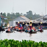 Rowing boats in a floating village in Chau Doc