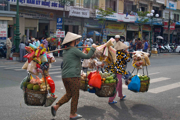 Street vendors in Saigon - Explore Vietnam and Cambodia 12 Days