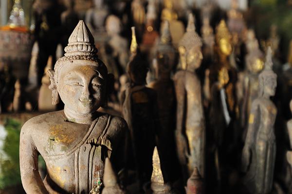 Buddha statues inside of Pak Ou cave