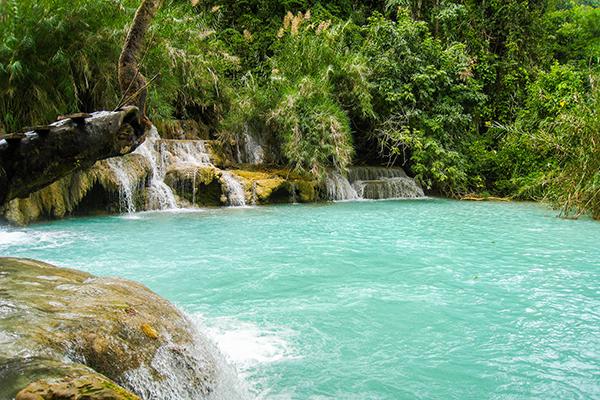 Deep blue water basins at Kuang Si Waterfall