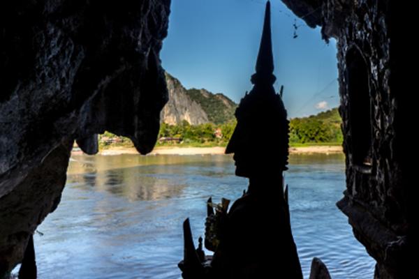 Inside Pak Ou cave, Buddha statues looking towards Nam Ou river