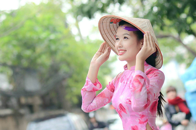 Ao Dai combined with Conical Hat