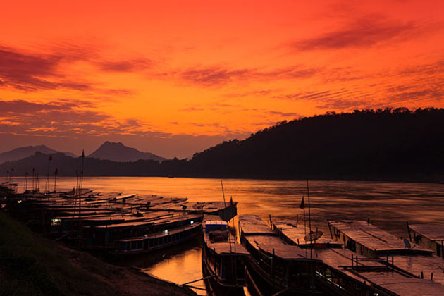 Go sailing on the Mekong River at sunset