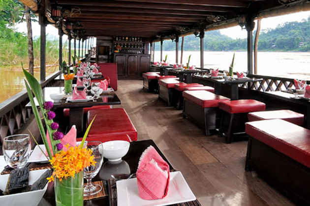 Sightseers enjoy a cruise dinner along the beautiful Mekong River