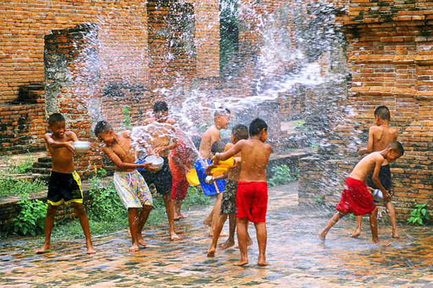 Cambodian children spray water to others in Chol Chnam Thmay, Cambodia