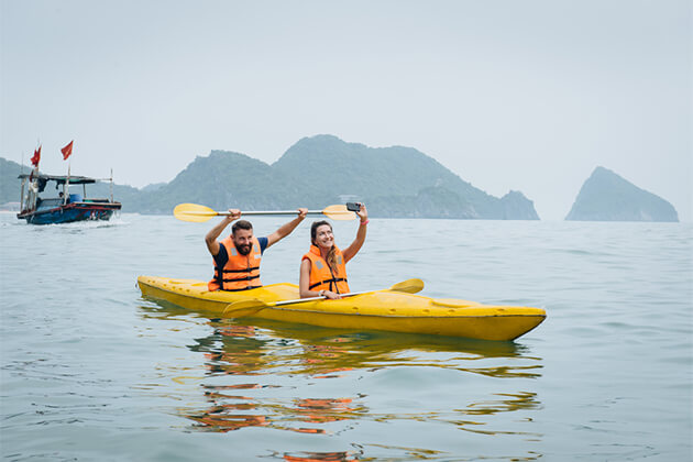 Couple Goes Kayaking on Halong Bay - Vietnam Cambodia Vacations