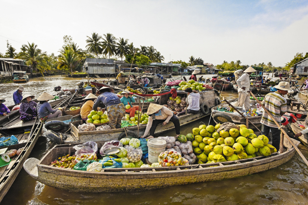 Cai Be Floating Market - Vietnam Laos 15 Day Tour