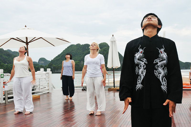 tai chi lesson at halong bay vietnam southeast asia tours