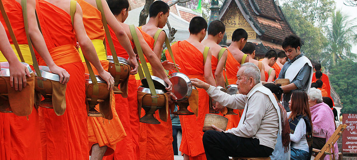 Alms Giving Ceremony in laos indochina tours