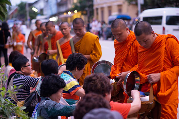 Morning Alms Giving Ritual - Indochina Tour Package 26 Days
