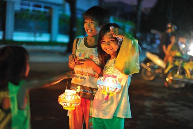 Vietnamese kids with colorful lanterns in Traditional Mid Autumn Festival