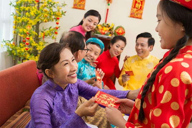 Vietnamese people get lucky money in Vietnamese Traditional New Year