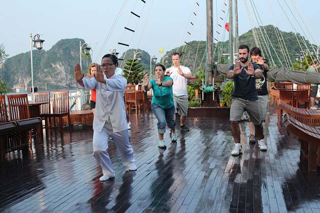 wake up and join tai chi class on halong bay cruise
