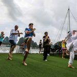 Tai Chi Exercises on Halong Bay Vietnam Laos Tour