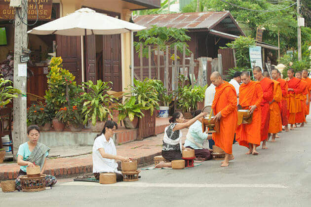alms giving luang prabang indochina 21 day tour