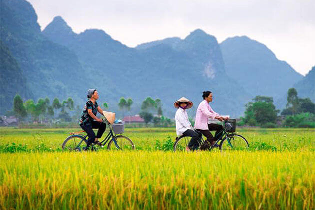 biking through the countryside vietnam laos tours