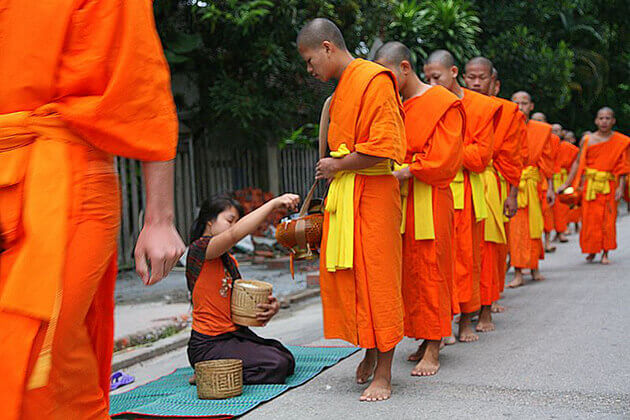 daily alms giving ceremony laos vietnam cambodia 4 week tour