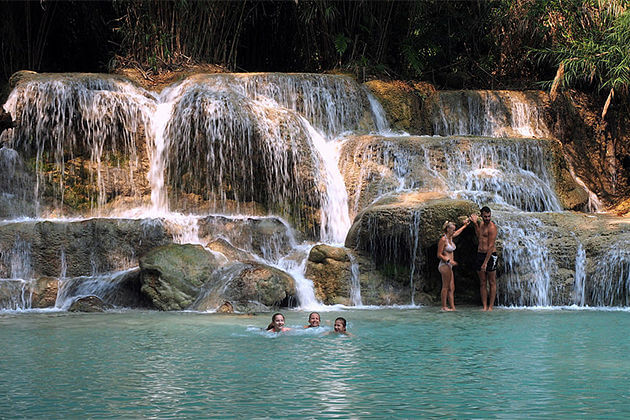 relax in kuang si waterfall laos vietnam travel packages